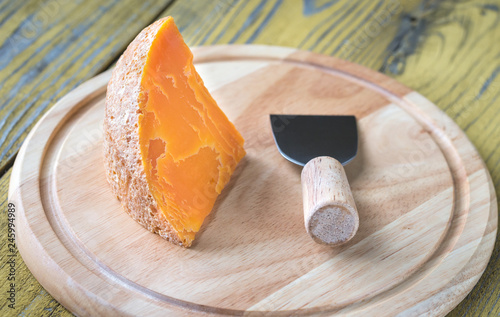 Mimolette cheese on the wooden board