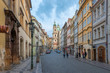 Prague, Czech Republic - August 25 2018: Early morning picture of Czech street in downtown Prague with tourists