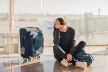Sad (tired) Woman Sitting In The Airport - Missed Or Cancelled Flight Concept.