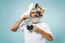 Surprised Senior Man Drinking Tea After Sleeping At Home Or Office Having Too Much Work. Bored Businessman With Pillow And Hourglass. The Busy, Boring, Worried, Be Late, Concerned, Sleep Day