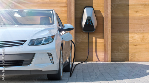 Foto electric vehicle of the future using smart electric car charging station at home