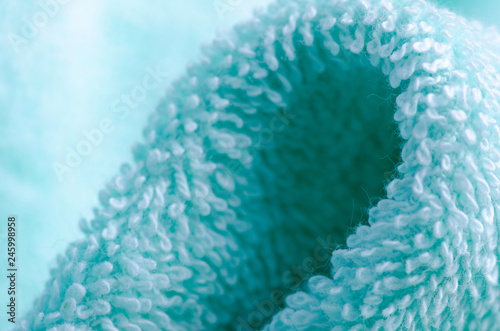 Foto auf AluDibond Kristalle Green azure towel macro fabric material soft bath blur background