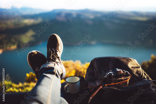 Fototapeta view trekking feet tourist backpack photo camera in auto on background panoramic landscape mountain, vacation concept, foot photograph hiking relax in auto, photographer enjoy trip holiday, mockup obraz