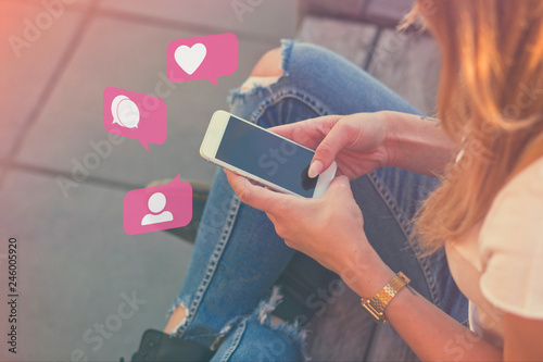 Fototapety, obrazy: Young Adult Girl Influencer Using Social Media on Smartphone on Outdoor, Like, Follower, Comment Bubble Icons