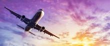 Modern Airplane Against A Sunset