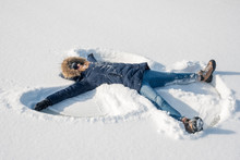 Making Snow Angels In Fresh Snow