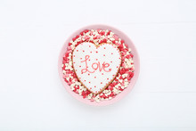 Valentine Day Cookie With Heart Shaped Sprinkles In Bowl On Wooden Table