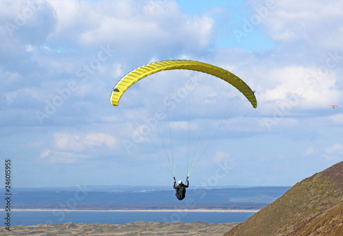Paraglider flying at Rhossili