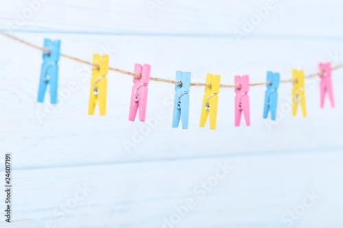 Papiers peints Pays d Afrique Colorful clothespins hanging on wooden background