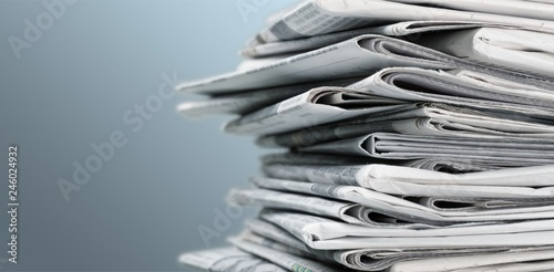 Fotomural  Pile of newspapers on white background