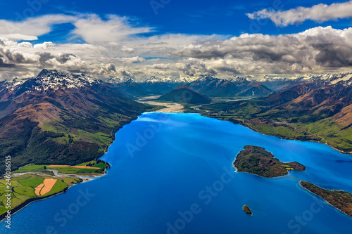 New Zealand, South Island, Otago region. The nothern end of Lake Wakatipu surrounded by Southern Alps, Pigeon Island on the left side, Dart River and Glenorchy settlement in the background