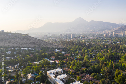 Amazing aerial views of Santiago de Chile city during the sunset with the Andes mountain range making a wonderful horizon line Canvas Print