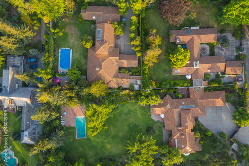 Amazing aerial views of Santiago de Chile city streets, neighbourhoods, beautiful lines, squares, swimming pools and amazing villas in eastern Santiago Canvas Print