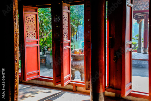 View through the red wooden doors of the Temple of Literature in Hanoi