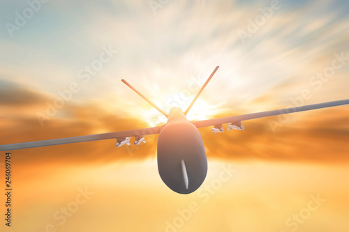 Military drone flight motion blur on sunset background. Close up view.