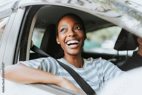 Fototapeta Happy woman driving a car