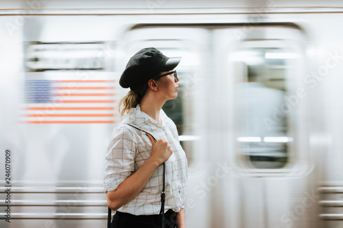 Thoughtful woman waiting for a train at a subway platform