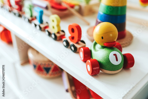 Set of kid toys on a white shelf