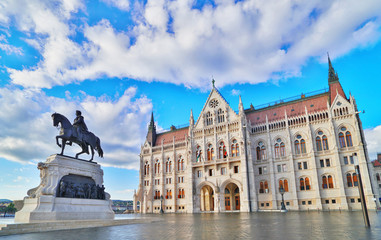 Budapest, Hungary. Statue of Count Gyula Andrassy on the Parliament Square in front of Beautiful building of Hungarian Parliament in Budapest, popular Europe travel destination.