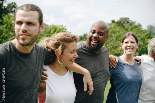 Group of people hugging each other in the park
