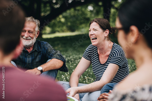 Fotografia, Obraz Cheerful woman in the park with her friends