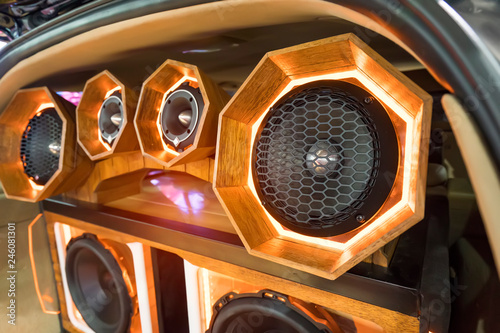 Fotografía  colorful lights of stereo and speakers in car in the night