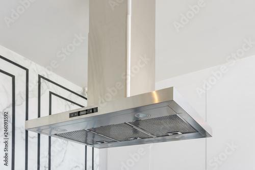 Fotografía  Modern stainless steel And Range hood in the kitchen interior