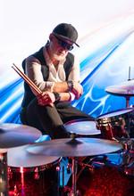 Drummer With Drum Sticks Sitti...
