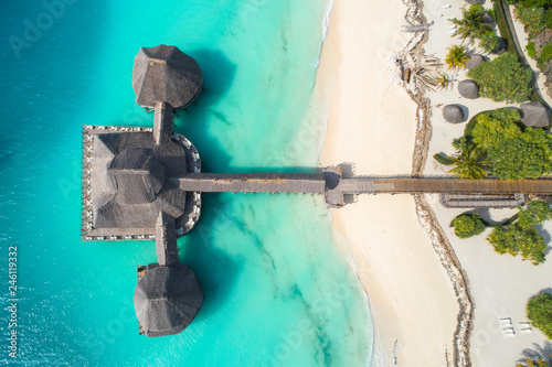 aerial view to beach and wooden restaurant in Tanzania
