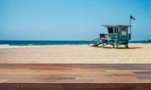 Lifeguard Tower On Venice Beach. Empty Table Top For Product Display Montage Background.