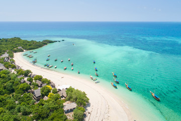 curved coast and beautiful beach with boats on Zanzibar island