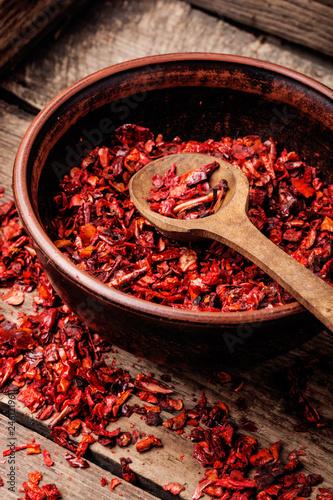 Staande foto Kruiderij Heap of red pepper flakes
