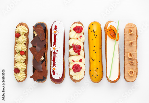 Fotografia Group of french dessert Eclair on white background, top view