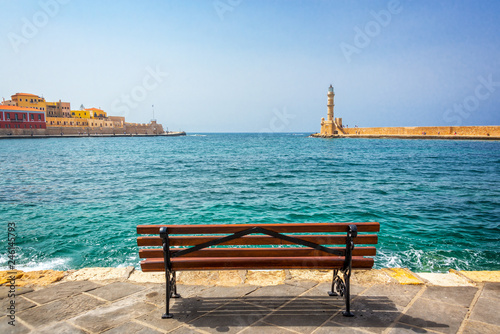 Deurstickers Europese Plekken Empty bench with view on the venitian habor of Chania in Crete, Grece