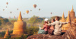 Happy tourists, friends, vacationers in the summer holidays in Asia