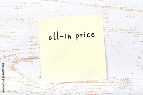 Photo Yellow sticky note with handwritten text allin price