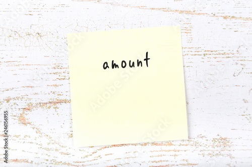 Yellow sticky note with handwritten text amount Canvas Print