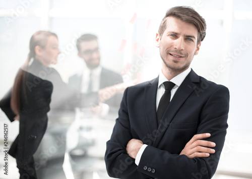 Fototapety, obrazy: successful businessman standing in a modern office