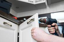 Professional Handyman Assembling Kitchen Door Cabinet.