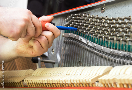 Vászonkép Professional master tuning the piano with ratchet tool.