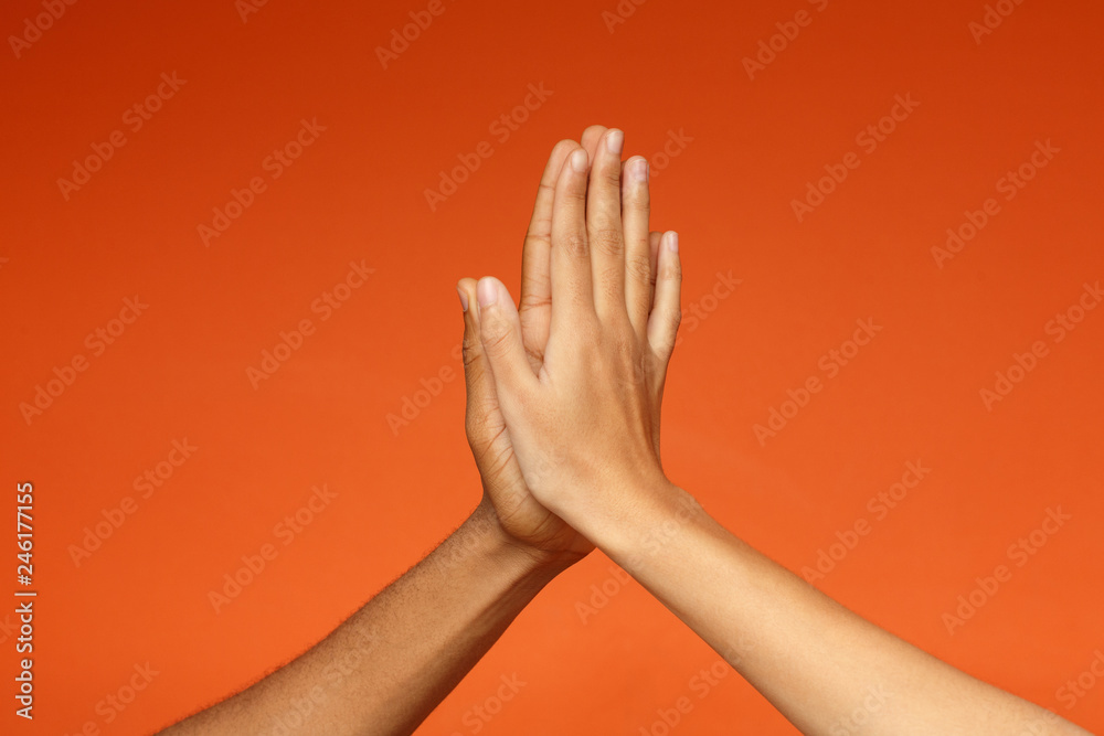 Fototapety, obrazy: Man and woman greeting each other with high five