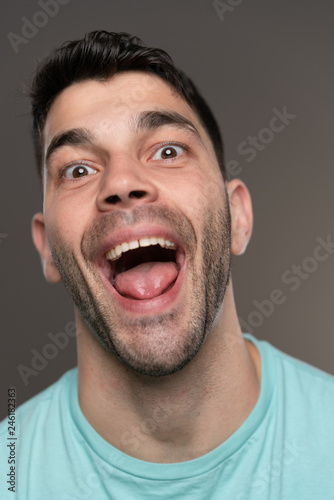 Handsome caucasian white male with black short hair and stubble with light blue Canvas Print