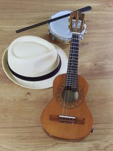 A Samba Player (sambista) Hat And Two Brazilian Musical Instruments: Cavaquinho And Tamborim With Drumstick. The Instruments Are Widely Used To Accompany Samba, A Popular Brazilian Rhythm.