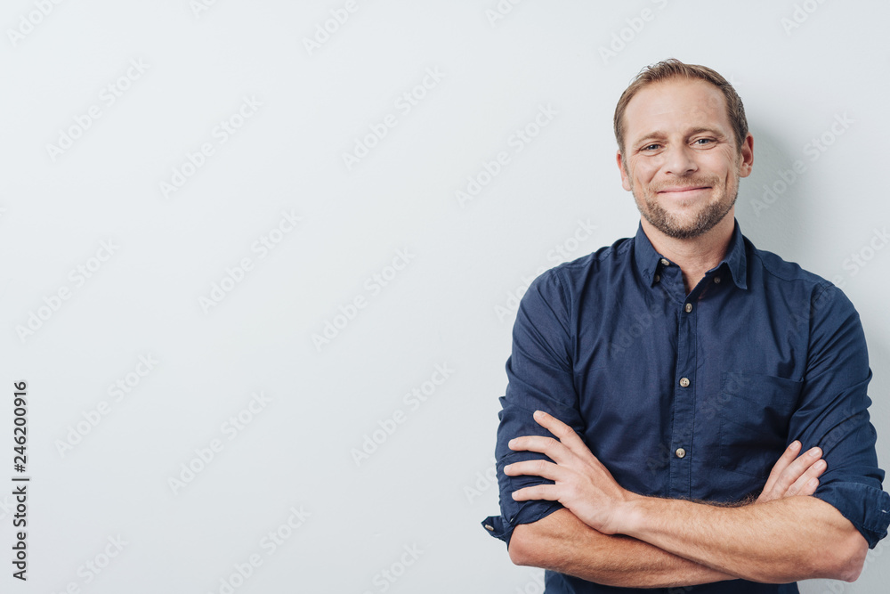 Fototapety, obrazy: Happy successful young man with a pleased smile