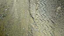 Tracks In Muddy Sand Road - 25FPS PAL