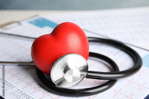 Obraz Stethoscope, red heart and cardiogram on table. Cardiology concept - fototapety do salonu