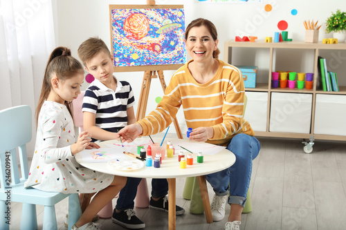 Fototapeta Children with female teacher at painting lesson indoors obraz na płótnie
