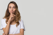 Young Woman Holding Finger On Lips Mouth To Keep It Quiet Hush Standing Isolated On White Grey Blank Studio Background With Copy Space, Millennial Gossip Girl Showing Shh Gesture Secret In Silence