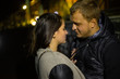 Young love couple in hugs and kisses on faro view , night photo