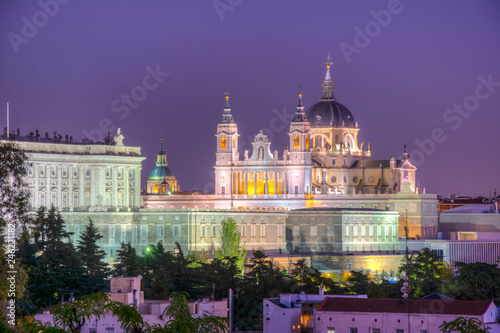 Sunset view of skyline of Madrid with Santa Maria la Real de La Almudena Cathedral and the Royal Palace, Spain